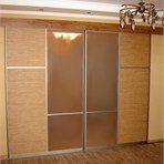 Sliding door wardrobes Room divider is created from materials of warm sandy colors