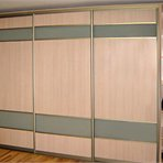 Sliding door wardrobes Sliding door wardrobe: light panels are built up in the golden frame