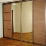 Sliding door wardrobes That am I all over: mirror and laminated chipboard